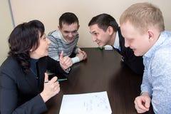 Gerente e trabalhadores no escritório Imagem de Stock