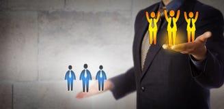 Gerente Lifting Winning Team Above Average Workers Imagens de Stock Royalty Free