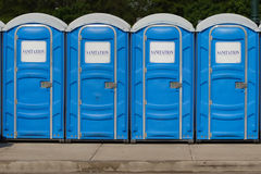 Gereric signage - Row of Portable Toilets Royalty Free Stock Photography