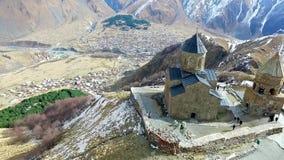 Gergeti church in Georgia, aerial stock video footage