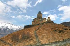 Gergeti trinity church at an elevation of 2170 meters, under Mount Kazbegi in Georgia. The Gergeti trinity church at an elevation of 2170 meters, under Mount Stock Images