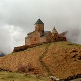Gergeti Tsminda Sameba church near Kazbegi. Village, Georgia, Caucasus Royalty Free Stock Photos