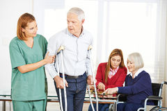 Geriatric caregiver with senior people Stock Photography