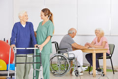 Geriatric nurse with group of senior people Royalty Free Stock Photography