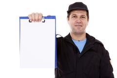 Gerijpt mannetje dat neer op bij whiteboard wijst Royalty-vrije Stock Afbeelding