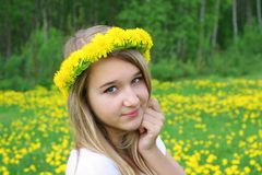 Gerl and flowers. The happy gerl with first spring flower Royalty Free Stock Photography