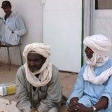 People chating in the street. Germa, Libya - May 06, 2002 : People chating in the street of Germa stock photos