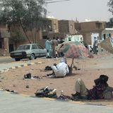 People resting and chating in the street. Germa, Libya - May 03, 2002 : People resting and chating in the street of Germa royalty free stock photos