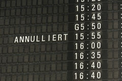 German airport departure board canceled information. A german airport departure board with canceled information Royalty Free Stock Image