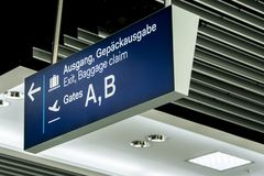German airport dusseldorf exit and baggage claim blue sign gates A and B. German airport dusseldorf exit and baggage claim blue sign to gates A and B Royalty Free Stock Photography