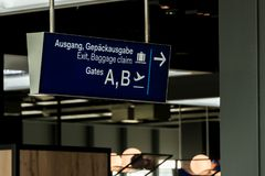 German airport dusseldorf exit and baggage claim blue sign gates A and B. German airport dusseldorf exit and baggage claim blue sign to gates A and B Royalty Free Stock Photo