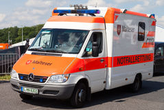 German ambulance car from Malteser drives on a street Stock Images