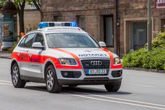 German ambulance car in use - Bavarian red cross Stock Photo