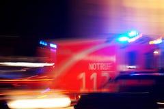 German ambulance driving fast at night stock illustration
