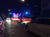 German ambulance at night. Berlin, Germany - October 20, 2018: German ambulance first aid. 112 is the single European emergency number that can be dialed free of royalty free stock image