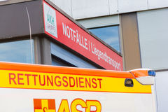 German ambulance vehicle stands on hospital Stock Image