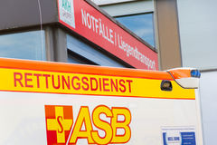 German ambulance vehicle stands on hospital Royalty Free Stock Photo