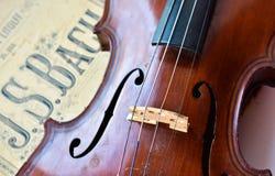 German ancient violin and notes. Royalty Free Stock Photo