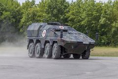German armoured medical carrier Boxer. FELDKIRCHEN / GERMANY - JUNE 9, 2018: German armoured medical carrier Boxer, from Bundeswehr, drives on a road at Day of Stock Images