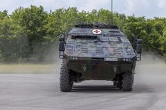 German armoured medical carrier Boxer. FELDKIRCHEN / GERMANY - JUNE 9, 2018: German armoured medical carrier Boxer, from Bundeswehr, drives on a road at Day of Royalty Free Stock Photos