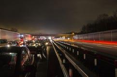 German autobahn at night. Traffic on German autobahn illuminated at night Stock Image