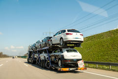 German autobahn with traile transporting cars Stock Photos