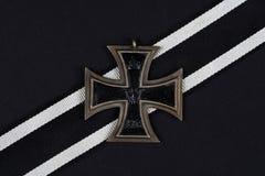 German award - Iron Cross on black. Background Stock Photos