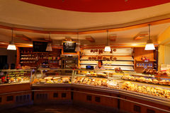 German bakery with saleswoman. A saleswoman behind the bread counter in a German bakery Royalty Free Stock Photography