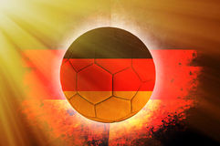 German ball. Soccer ball with German flag as the background stock illustration