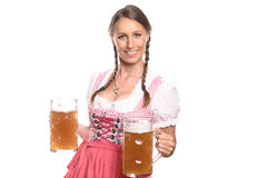 German or Bavarian waitress with beer mugs Stock Images