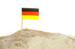 German beach. With sand dunes and flag Royalty Free Stock Image