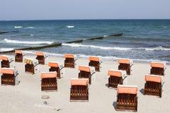 German beach chair Strandkorb. Sand Stock Photo