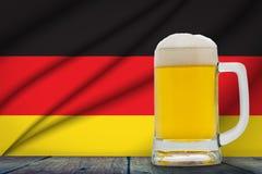 German Beer. Big mug with cold beer in front of the German flag royalty free illustration
