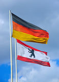 The German and the Berlin flag. Waving in the wind Royalty Free Stock Photos