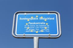 German border sign. And passport control stock images