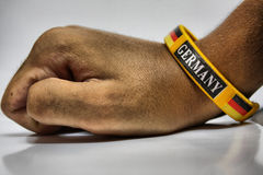 Germany bracelet. German bracelet with the flag of germany in a hand Stock Photography