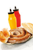 German Bratwurst, fried sausage and bread roll Stock Photos