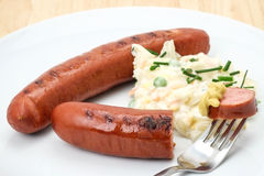 German Bratwurst sausage with coleslaw Royalty Free Stock Photos
