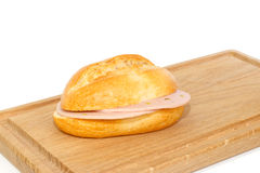 German bread roll with mortadella on breakfast tray Stock Image