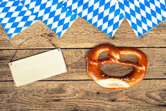 German bretzels. On wooden background with empty sign for your text Stock Images