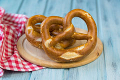 German bretzels on wooden background. German bretzels on a light blue wooden background Royalty Free Stock Photography