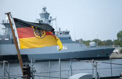 German Bundesdienstflagge blows on warship. German Bundesdienstflagge blows on a warship stock image