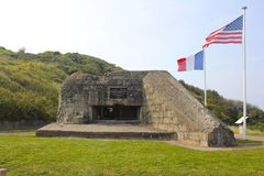 German Bunker, Omaha Beach, American and French Flags Royalty Free Stock Image