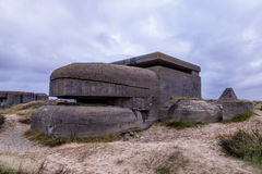 German bunker. Sinister looking German World War 2 bunker in the dunes of the Atlantikwal against a clouded sky Royalty Free Stock Photo