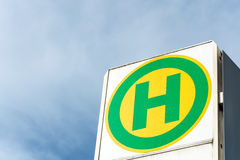 German bus stop sign close up. In the sun Stock Photography