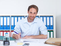 German businessman at office writing note Stock Image