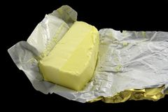 German butter. Isolated on black Royalty Free Stock Photos