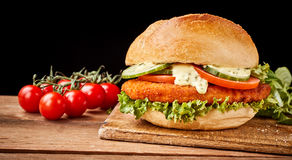 In german called Schnitzelbrötchen with cherry tomatoes Stock Images