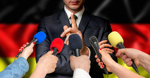 German candidate speaks to reporters - journalism concept Stock Image