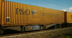 German cargo train. GERMANY - CIRCA 2016: Industrial train passing transporting containers P&O Ferrymasters and Transmec stock footage